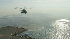 Dramatic! Helicopter Lands on Deck  (HD) c - stock footage