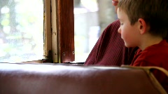 Father and Son on Train Ride - stock footage