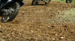 Motocross bikes on muddy course Stock Footage