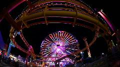 Roller Coaster and Ferris Wheel on Santa Monica Pier at Night Stock Footage