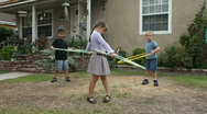 Stock Video Footage of Silly Kids Hula Hooping Outdoors