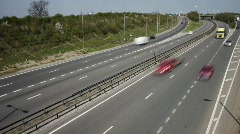Road traffic at a  junction on the A14 dual carriageway. - stock footage