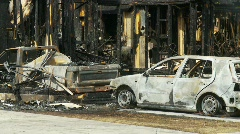 Fire, house fire aftermath with burnt cars Stock Footage
