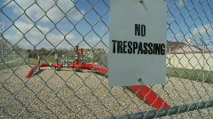 oil & gas, No trespassing sign, gas pipeline fenced wide - stock footage