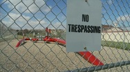 Oil & gas, No trespassing sign, gas pipeline fenced wide Stock Footage