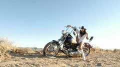Sexy woman dismounting her motorcycle Stock Footage