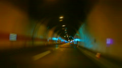 Car driving on highway tunnel looping - stock footage