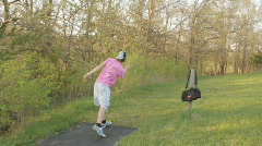 Disc Golf (frisbee) player on course teeing off Stock Footage