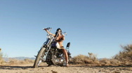 Sexy brunette in high heels with motorcycle Stock Footage
