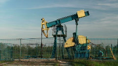 An oil pump jack in action  Stock Footage