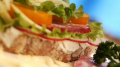 Stock video footage sandwich with meat and greens - stock footage