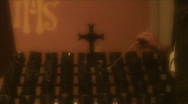 Lighting Candles in Church Stock Footage