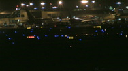 Busy airport at night 44 Stock Footage