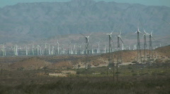 Windfarm zoom out to railroad tracks Stock Footage