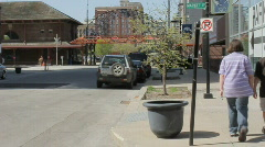 Two youths walking downtown - Des Moines - stock footage