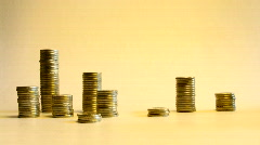 Reallocate stacks of coins illustrating transfer money Stock Footage