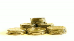 Stock Video Footage of growing pyramid of coins isolated on white, moving camera and static var