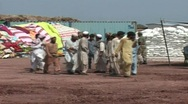 Stock Video Footage of Blankets, Food & Aid for Internally Displaced Persons (IDP's) in Swat, Pakistan