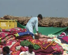 Blankets, Food & Aid for Internally Displaced Persons (IDP's) in Swat, Pakistan Stock Footage