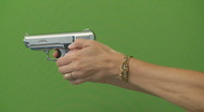 Woman with gun green screen Stock Footage