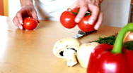 Slicing tomato Stock Footage