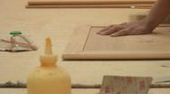 Cabinetry shop - 11 - hand sanding block on a cabinet door Stock Footage
