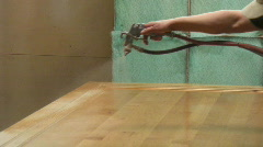 Cabinetry shop - 13 - lacquer spray booth on a large wood panel Stock Footage