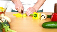 Slicing yellow pepper Stock Footage