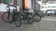 Stock Video Footage of Basel bikes on cobblestone street