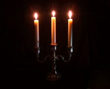 Three candles in candelabrum Stock Footage