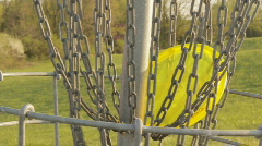Disc Golf (frisbee) from goal closeup Stock Footage