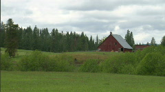 Mountain Meadow with Red Barn 1 Stock Footage