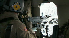 (Loud) Helicopter door gunner firing machine gun (HD) c - stock footage