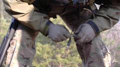 Special Operator prepares explosives (HD) c - stock footage