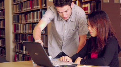 Students Working in Library - stock footage