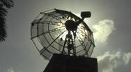Stock Video Footage of Sun behind old satellite dish antenna