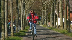 Woman on bike, Borkum, Germany Stock Footage