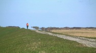 Bicycle ride on dike (mirage) Stock Footage