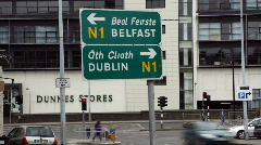 Traffic Sign Timelapse road to  Dublin and Belfast Ireland Stock Footage