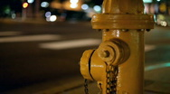 Cars Passing Fire Hydrant at Night Stock Footage