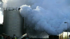 Steam blow testing at power plant under construction Stock Footage