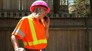 Stock Video Footage of Woman in pink hardhat on cell