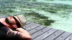 Handsome man resting near water at Maldives Stock Footage