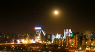 Moon over city Stock Footage
