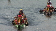 Stock Video Footage of Dragon Boats Move To The Start Line Of The Race