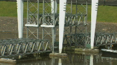Ship (oil tanker)  gliding under the railway bridge Stock Footage