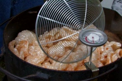 Cooking pork rinds at a barbecue Stock Footage