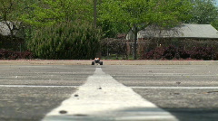 RC truck racing down white lane Stock Footage