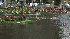 Dragon Boats Cross The Finish Line Of A Race - stock footage