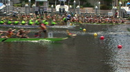 Stock Video Footage of Dragon Boats Cross The Finish Line Of A Race